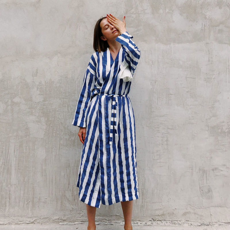 woman in blue and white striped dress covering her left eye 1182702 1 800x800 - Homepage with products carousel